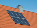 Solar panels small house on the roof of a Stock Photo
