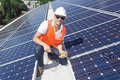 Solar panels with technician young installing on factory roof Royalty Free Stock Photos