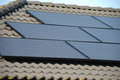 Solar panels on top of a roof Royalty Free Stock Photography