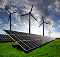 Solar panels and wind turbine Stock Images