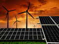 Solar panels and wind turbine Stock Photography