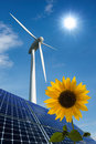 Solar panels, wind turbine and sunflower Royalty Free Stock Photography