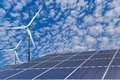 Solar panels and wind turbines alternative energy Royalty Free Stock Photo
