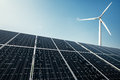 Solar panels and a windmill generate electricity from the sun Royalty Free Stock Photo