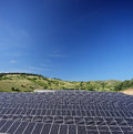 Solar photovoltaic cell panels on field under blue sky at macedo macedonia shot with a tilt and shift lens Stock Photos