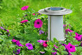 Solar powered garden lamp in garden. Royalty Free Stock Photography