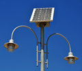 Solar powered lamp post street with panel energy against blue sky Royalty Free Stock Photos