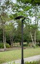 Solar-powered lantern post in the park Royalty Free Stock Photo