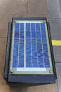 Solar powered panel at top of traffic control box Stock Images