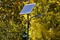 Solar street lamp in a park in autumn Royalty Free Stock Photo
