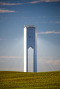 Solar Tower with rays  - thermo-solar power - blue sky and green Royalty Free Stock Photo