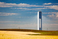Solar tower with rays thermo solar power blue sky and yello yellow field horizontal Royalty Free Stock Image