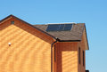 Solar water heating system on bitumen roof of the house. Royalty Free Stock Photo