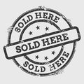 Sold here rubber stamp isolated on white. Royalty Free Stock Photo