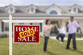 Sold Real Estate Sign and Hispanic Family at House Royalty Free Stock Photo