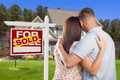 Sold for sale sign with military couple looking at house real estate and affectionate nice new Stock Photography