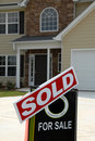 SOLD Sign in Front of New Home Stock Image