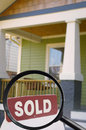 Sold sign house for sale with and magnifying glass Royalty Free Stock Images