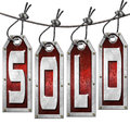 Sold Tags Hanging on White Background Stock Photo
