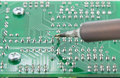 The solder electronics pcb with the soldering iron print circuit board Stock Image
