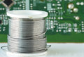 Solder wire electronic coil circuit board background Royalty Free Stock Photos