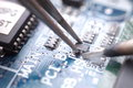 Soldering and assembly of smd transistor manual macro focus Stock Photography