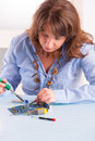 Soldering woman using tool for the computer parts Royalty Free Stock Photos