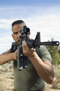Soldier Aiming Machine Gun Stock Photo