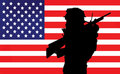 Soldier and American flag Stock Images