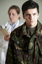 Soldier Being Assessed By Doctor Royalty Free Stock Photo