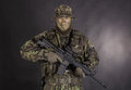 Soldier in camouflage and modern weapon m on black background Royalty Free Stock Image