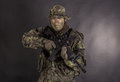 Soldier in camouflage and modern weapon m on black background Stock Photos