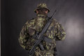 Soldier in camouflage and modern weapon m on black background Stock Photo