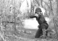 Soldier Firing M1 Rifle from Kneeling Position Stock Image