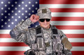 Soldier and flag us on background Stock Images