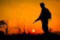 Soldier and gun in silhouette shot