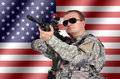 Soldier with his assault rifle on flag background Royalty Free Stock Photography
