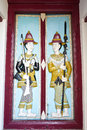 Soldier hold gun and spear on door of the building which is located the temple of the emerald buddha Stock Photography