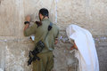 Soldier and jewish Prayer at the Western Wall Royalty Free Stock Photo