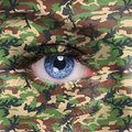 Soldier jungle camouflage on human face Stock Photography