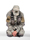 Soldier kneeling us on white background Royalty Free Stock Photo