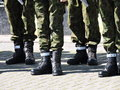 Soldier legs with boots lithuania Stock Images