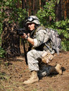 Soldier with M4 Carbine aiming Royalty Free Stock Photo