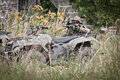 Soldier on patrol special forces hidden behind all terrain vehicle Royalty Free Stock Photography