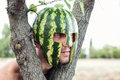 Soldier photo of the young with a water melon on a head Royalty Free Stock Photos