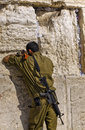 Soldier Praying at The Western Wall Stock Image