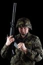 Soldier reloading magazine of m16 Royalty Free Stock Photography