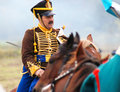 A soldier rides a brown horse an unknown with mustache in uniform recorated by epaulettes borodino historical reenactment Royalty Free Stock Image