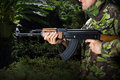 Soldier with rifle ak in jungle Royalty Free Stock Photos