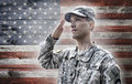 Soldier saluting on the grunge american flag background us army wooden backgound Stock Photo